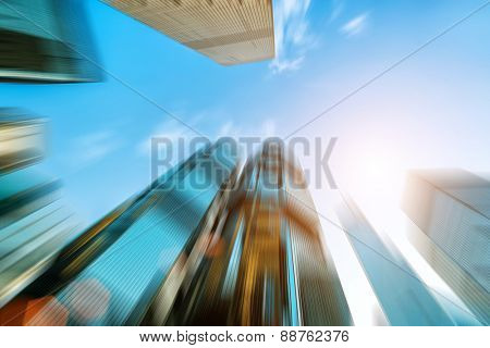 low angle view of skyscrapers in blurred motion.