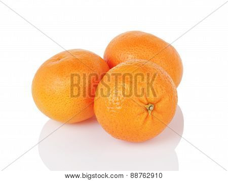 three ripe tangerines isolated on white