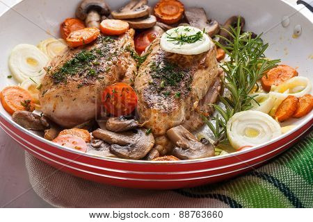 Baked Chicken Breast With Mushrooms And Carrots On The Pan