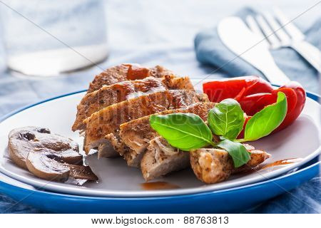 Baked Chicken Breast Sliced On Plate