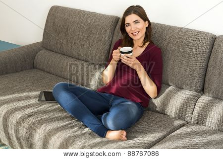 Beautiful woman at home relaxing after work