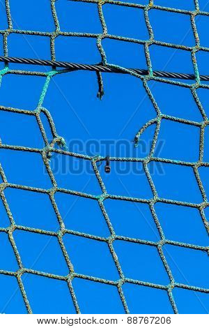 hole in a network, the symbol of captivity, obstacle, hoping to damage