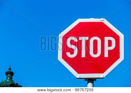 a stop sign by the roadside. photo icon for support and exit