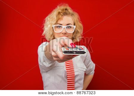 Young Woman Holding Remote Control, Focus On Remote.