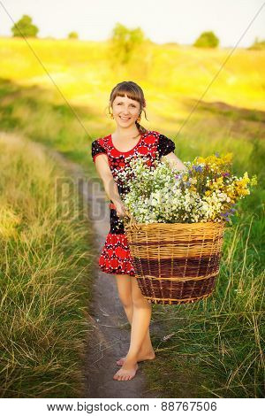 Close Up Portrait Of Happy Young Woman With With Basket Full Of Field Flowers