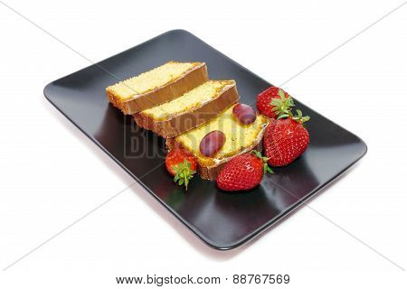 Cake With Glaze Of Chocolate And Strawberries  In The Black Dish Isolated On White