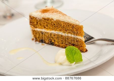 Slice Of Carrot Cake With Mint Garnish