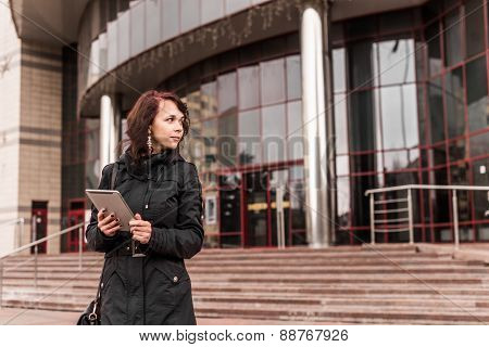 Young woman with Tablet reading