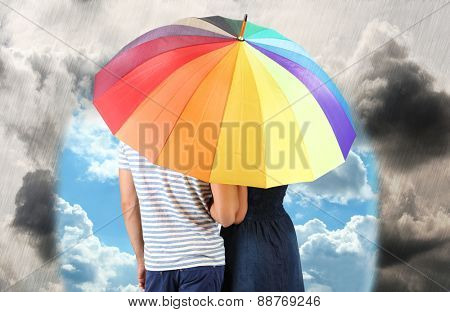 Beautiful loving couple with umbrella in rain day