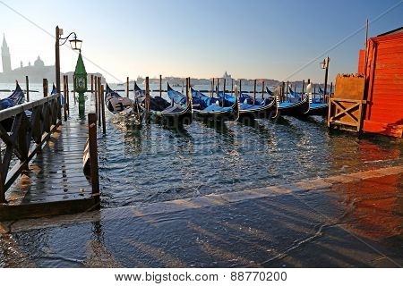 Gondolas In Venice In Italy During High Tide