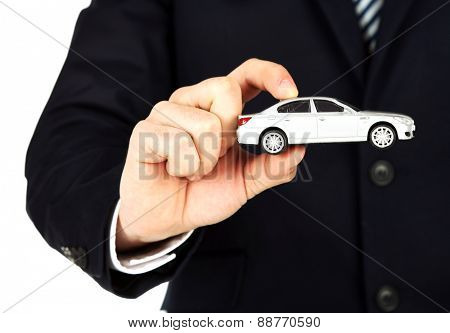 Man holding model of car in his hand