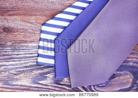 Various of ties on wooden background