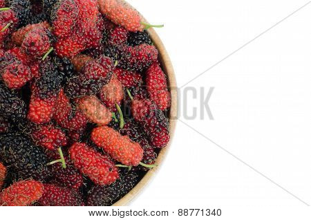 Mulberry In Wooden Bowl Isolated On White Background