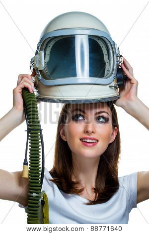 Woman with vintage astronaut helmet