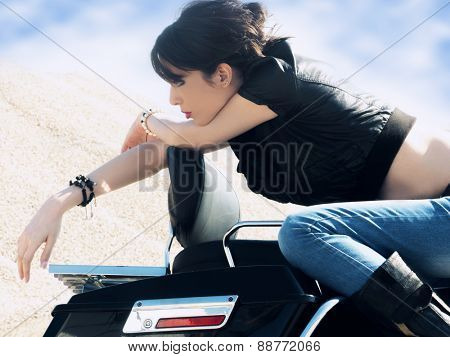woman on the old fashion motorbike