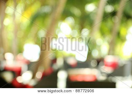 Blurred background of restaurant platform with seats in resort