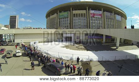 MOSCOW, RUSSIA - APRIL 5, 2014: People stand at the Olympiysky Sports Complex during the biathlon competition - Race of Champions. Race of Champions held since 2011