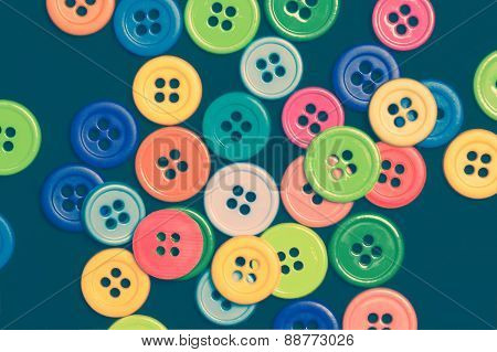Sewing buttons on a dark background