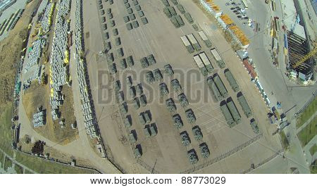 MOSCOW, RUSSIA - APRIL 20, 2014: Tanks and military vehicles is parked at Khodynskoe Field prepared for the parade of victory, aerial view
