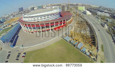 MOSCOW, RUSSIA - APRIL 20, 2014: The road next to the building of the Palace of Sports Megasport and construction site. The palace was opened December 15, 2006