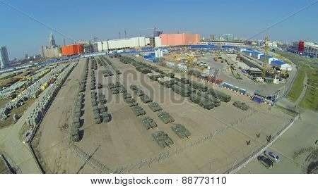MOSCOW, RUSSIA - APRIL 20, 2014: Military vehicles at Khodynskoe Field prepared for the parade of victory and construction site of shopping center Aviapark, aerial view