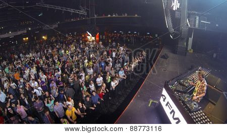 MOSCOW, RUSSIA - APRIL 5, 2014: Stage and a crowd of people at the nightclub Stadium Live during trance festival TRANSMISSION, aerial view. This festival is held for more than 10 years