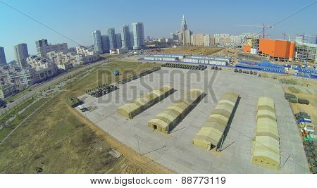MOSCOW, RUSSIA - APRIL 20, 2014: Hodynskoe field with military equipment prepared for the parade of victory and alley Pilots heroes, aerial view