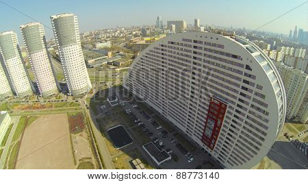MOSCOW, RUSSIA - APRIL 20, 2014: Cityscape with residential house Parus at spring sunny day, aerial view. Complex is winner of House of Year award in 2008