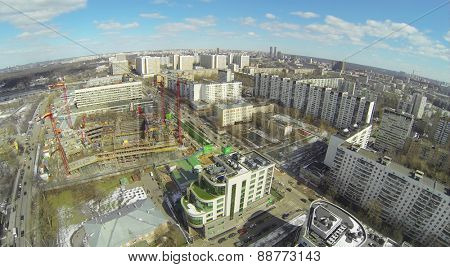MOSCOW, RUSSIA - APRIL 05, 2014: Cityscape with residential buildings and construction site of television company NTV, aerial view