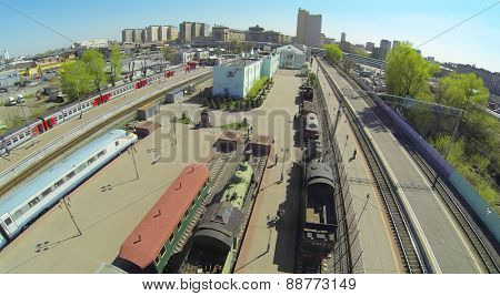 MOSCOW, RUSSIA - APRIL 26, 2014: Trains at a Rizhsky Railway Station on a sunny spring day, aerial view. Four ways between platforms an exposition of the museum of history of rail transport