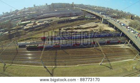 MOSCOW, RUSSIA - APRIL 10, 2014: Cityscape with traffic on Rizhskaya overpass and railways with trains at sunny spring day, aerial view