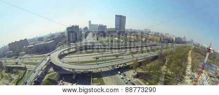 MOSCOW, RUSSIA - APR 20, 2014: Car traffic on a junction at the intersection of Third Ring Road and Leningradskoe highway against cityscape, aerial view