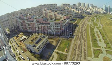 MOSCOW, RUSSIA - APRIL 20, 2014: Hodynskoe field with residential buildings near alley of Pilots Heroes at spring sunny day, aerial view