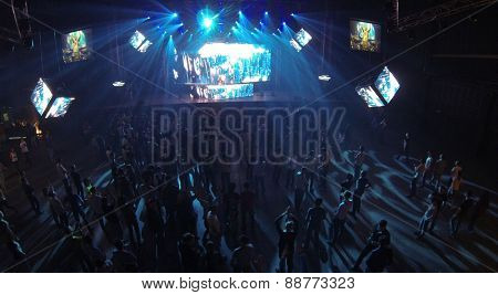 MOSCOW, RUSSIA - APRIL 5, 2014: People on the trance festival TRANSMISSION in a nightclub Stadium Live, aerial view. This festival is held for more than 10 years