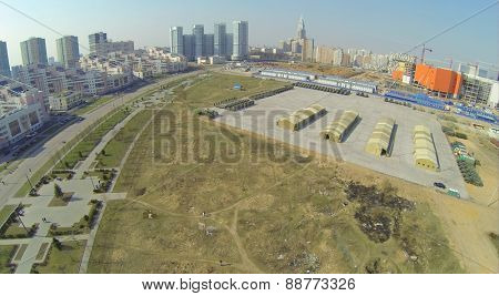 MOSCOW, RUSSIA - APR 19, 2014: Alley of Pilots Heroes near military machines prepared for Victory Day Parade and construction site of trade center Aviapark at spring sunny day, aerial view