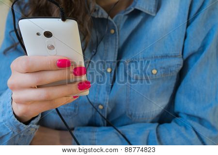 Girl In A Denim Shirt Listens To Music On The White Phone