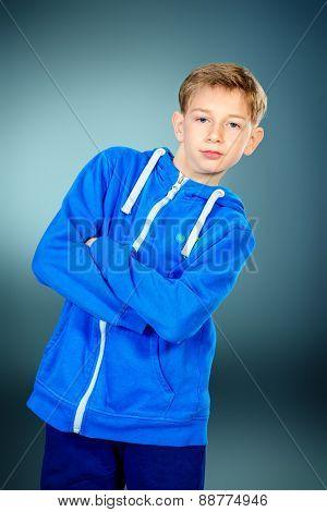 Portrait of a smiling teen boy in casual sportswear. Studio shot.