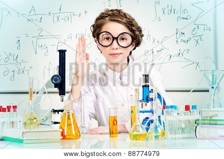 Student girl doing research in the laboratory. Science and education.