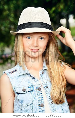 Modern girl teenager posing outdoor.