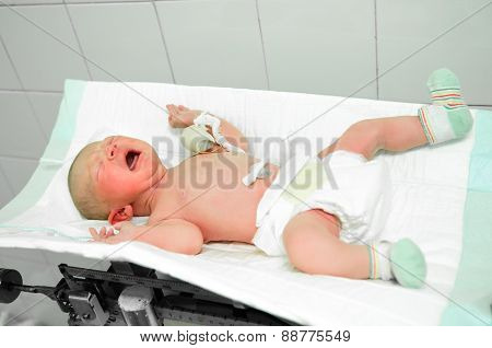 Weighing The Newborn Baby