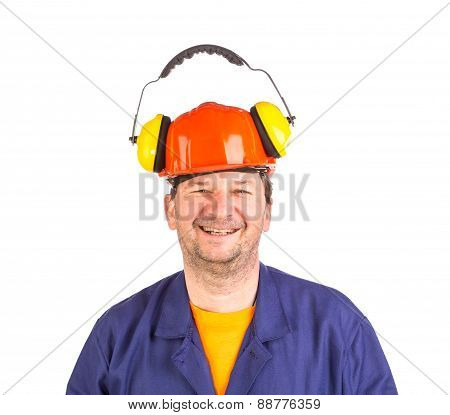 Worker in hard hat and ear muffs