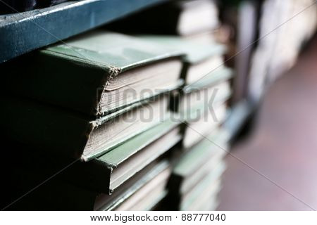 Many books on bookshelf in library, closeup