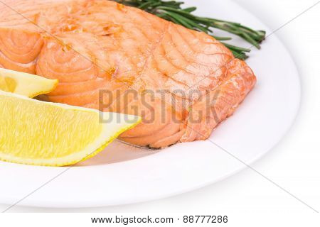 Salmon fillet on plate with lemon