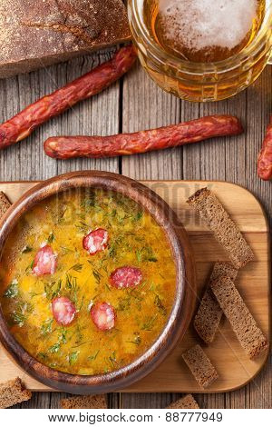 Rustic traditional beer soup with dill croutons and bread
