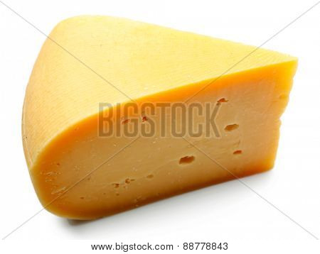 Piece of tasty cheese isolated on white
