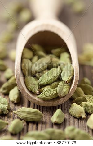 Cardamom green seeds superfood ayurveda spice in a wooden shovel