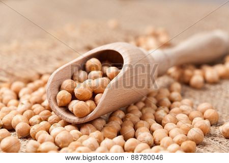 Dry chickpeas healthy nutrition food in wooden spoon on vintage