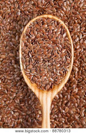 Flax seeds super food in vintage wooden spoon