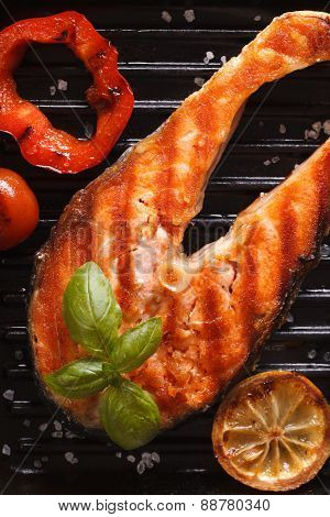 Steak Salmon And Vegetables On The Grill Pan. Vertical Top View