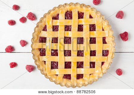 Gourmet homemade raw raspberry pie with jam on white kitchen table
